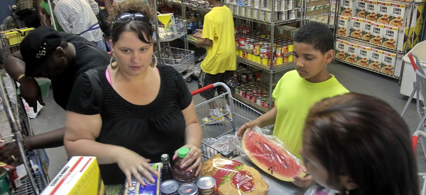 Low-income families visit a food pantry. Some advocates say Tennessee's large surplus of federal aid for needy families is contributing to stress among low-income families.