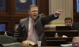U.S Rep. Mike Bost, formerly a state representative, shouts in a gun debate at the Illinois state legislature in 2013.