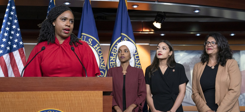 "Rep. Ayanna Pressley speaks at a press conference with the other members of ""The Squad,"" Reps. Ilhan Omar, Alexandria Ocasio-Cortez, Rashida Tlaib."