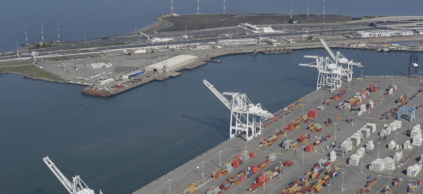 The former Oakland Army Base pier at left and the Port of Oakland at lower right in Oakland, Calif., as seen in February 2016. A developer is seeking to build a bulk cargo terminal that would handle coal and other goods at the former Army base site.