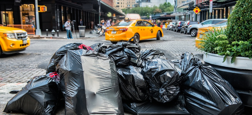 New York City Mayor Bill de Blasio signed a law this week to place new regulations on commercial trash collection in the city.
