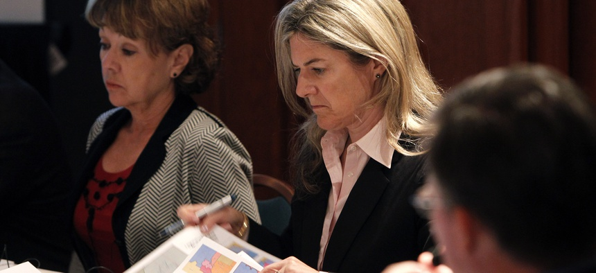 Colleen Coyle Mathis examines redistricting maps at a meeting of the Arizona Independent Redistricting Commission in Tempe in 2011. As chairwoman of the panel, Mathis was attacked by state politicians and members of the public.