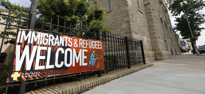 A sign hangs outside Central Presbyterian Church in Atlanta welcoming immigrants and refugees. Atlanta will continue to resettle refugees in 2020.