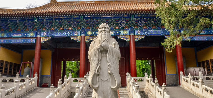 Statue at the entrance of the Temple of Confucius in Beijing, China