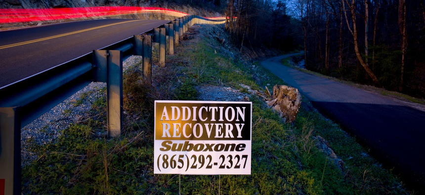 An addiction recovery sign stands beside a road in LaFollette, Tenn., Wednesday, April 11, 2018. In 2015, Campbell County had the third-highest amount of opioids prescribed per person among all U.S. counties, according to the CDC.