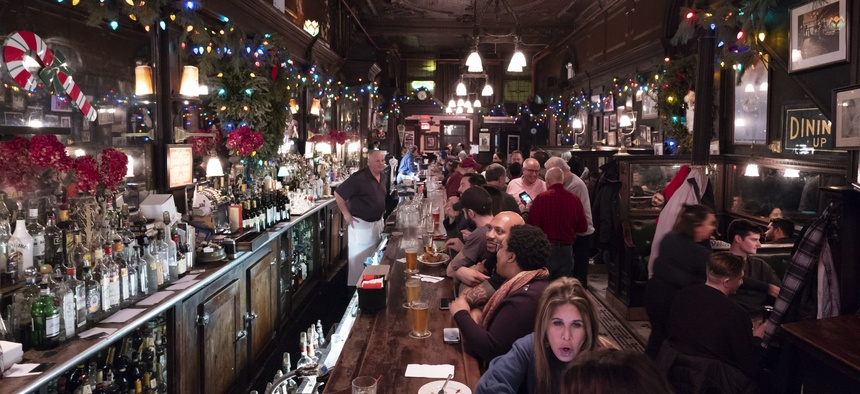 In this Dec. 27, 2019 photo, customers mingle in New York's Old Town Bar. Once a speakeasy during Prohibition, the Old Town Bar opened in 1892.