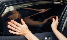 Under current law, car windows must let in at least 70 percent of light.