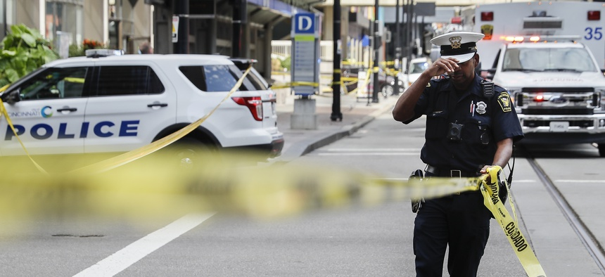 Emergency personnel and police work the scene of shooting near Fountain Square, Thursday, Sept. 6, 2018, in downtown Cincinnati.