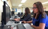 In this April 30, 2015 photo, Sylvia Fonseca, 16, works in the computer lab at Cuyama Valley High School in California. The school district has internet connections about one-tenth the minimum speed recommended for the modern U.S. classroom.