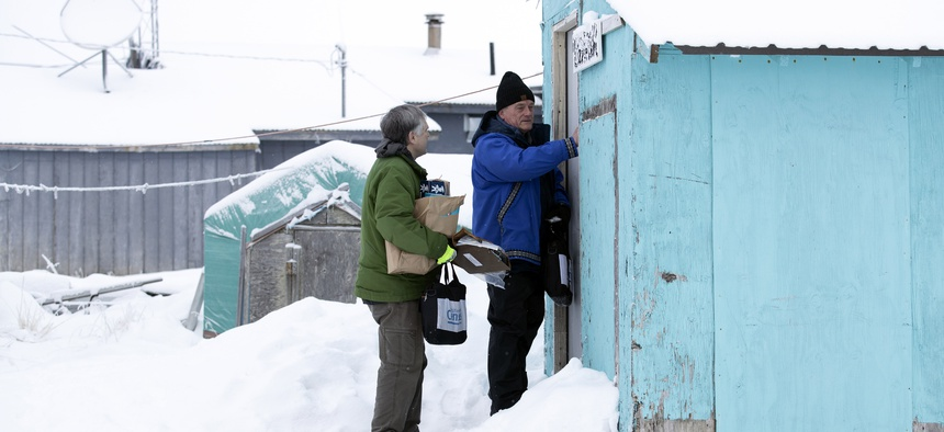 Census bureau director Steven Dillingham, right, knocks on the door alongside Census worker Tim Metzger as they arrive to conduct the first enumeration of the 2020 Census Tuesday, Jan. 21, 2020, in Toksook Bay, Alaska.