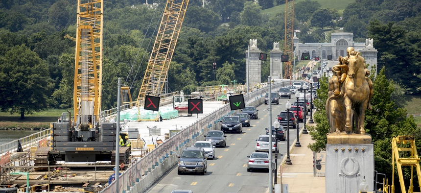 The entrance to Arlington National Cemetary is visible from the Lincoln Memorial as restoration work continues on Memorial Bridge over the Potomac River, Tuesday, July 2, 2019, in Washington.