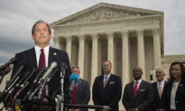 Texas Attorney General Ken Paxton and a bipartisan group of state attorneys general speaks to reporters in front of the U.S. Supreme Court in Washington, on Monday, Sept. 9, 2019.