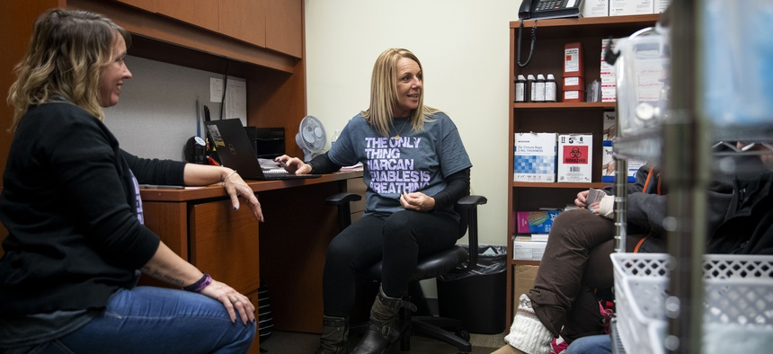 Charmin Gabbard (center) and Darci Moore (left) gather information from two participants at the syringe exchange run by Fayette County Harm Reduction Alliance in Connersville, Indiana, on Jan. 23, 2020. The exchange had reopened the day before.
