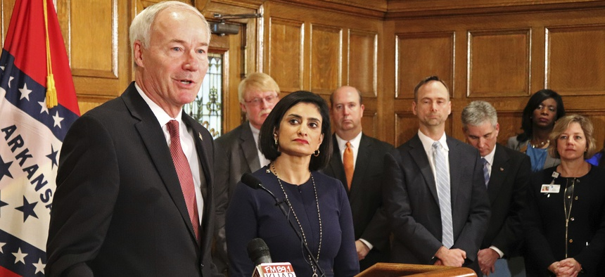 Gov. Asa Hutchinson speaks at a March 2018 news conference about Medicaid work requirements at the state Capitol in Little Rock, Ark., with Seema Verma, the head of the Centers for Medicare and Medicaid Services.