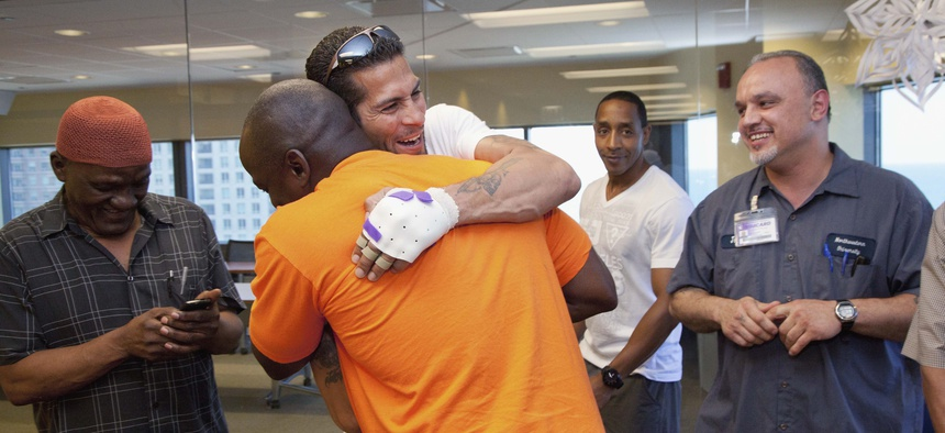 Daniel Taylor of Chicago was exonerated in 2013 after spending nearly two decades in prison for a double homicide he didn't commit. He was greeted by fellow exonorees afterwards. A new bill would make expungement easier for people who have been exonerated