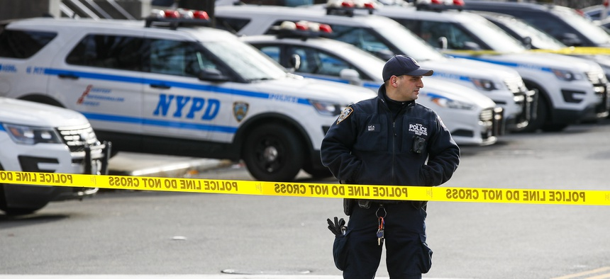 New York police set up a perimeter outside the 41st police precinct at the scene of a police involved shooting, Sunday, Feb. 9, 2020, in New York.
