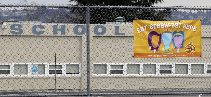 A sign promoting breakfast being served at Lowell Elementary School in Tacoma, Wash., is shown Tuesday, March 10, 2020.