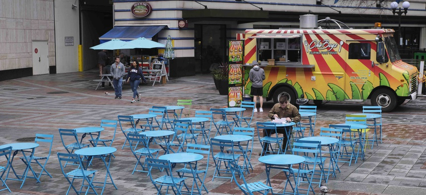 A nearly empty dining area near where food trucks park at a downtown park is pictured, Wednesday, March 11, 2020, in Seattle.