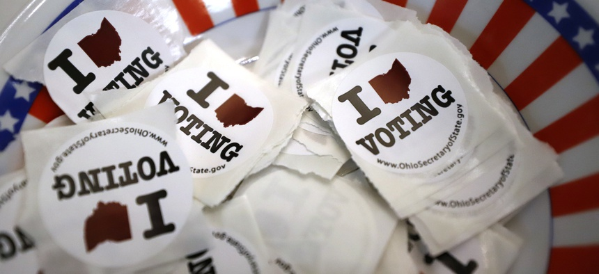 This Sunday, March 15, 2020, file photo shows a bowl of stickers for those taking advantage of early voting in Steubenville, Ohio.
