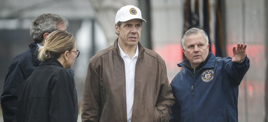 New York Governor Andrew Cuomo tours a COVID-19 infection testing facility. On Monday, the governors of New York, New Jersey, and Connecticut established three-state guidelines on social distancing and limits on recreation.