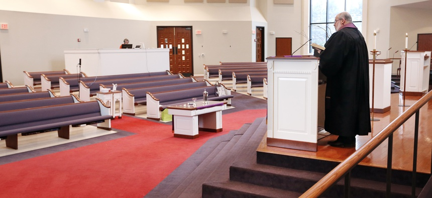Rev. Kip Rush delivers his sermon on March 15, 2020 in a sanctuary filled with mostly empty pews at Brenthaven Cumberland Presbyterian Church in Brentwood, Tenn. The church decided to broadcast the service instead of holding regular services.