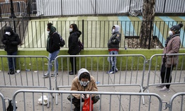 People wait outline outside a Covid-19 testing facility in New York.