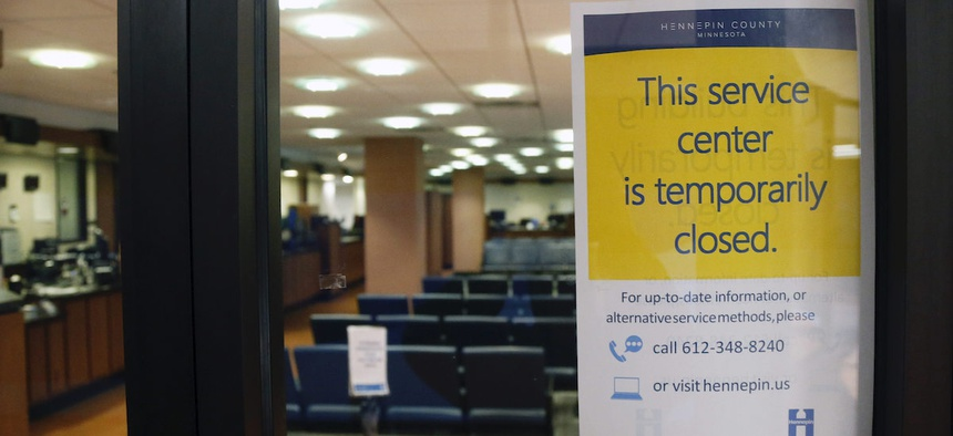 The Hennepin County Government Center stands closed Tuesday, March 17, 2020 in Minneapolis where efforts to slow the spread of the coronavirus continue. (AP Photo/Jim Mone)