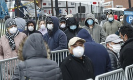 People wait in line at a coronavirus testing site in New York.
