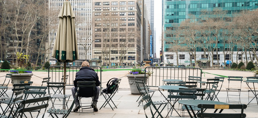 A man sits alone in New York City.