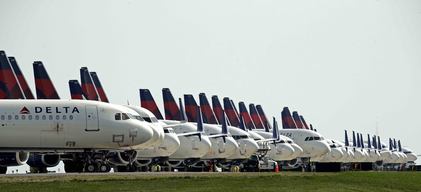 Mothballed Delta Air Lines jets are parked at Kansas City International Airport Wednesday, April 1, 2020 in Kansas City, Mo. Air travel has plummeted as the nation fights the coronavirus. That's raising budget concerns for communities near airports.