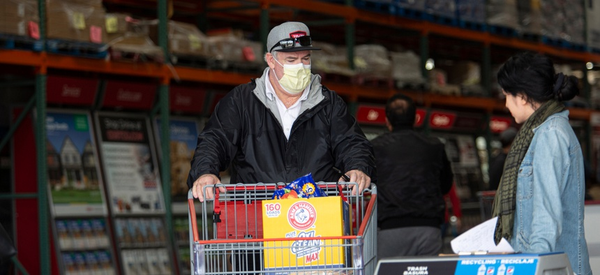 A man shopping for groceries in Los Angeles wears a face mask. Mayor Eric Garcetti last week issued a call for all residents to wear masks when interacting in public.