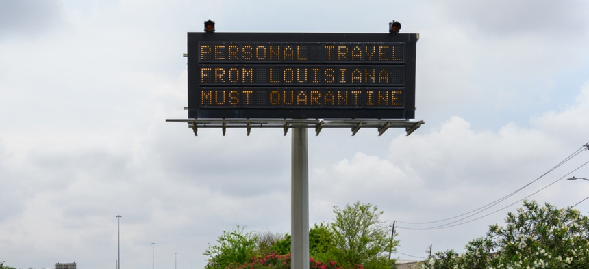 A sign in Texas orders out-of-state visitors to quarantine for two weeks.