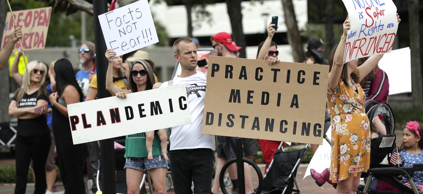 Protesters in Florida showed a deep suspicion of efforts to shut down daily life to slow the spread of the coronavirus.