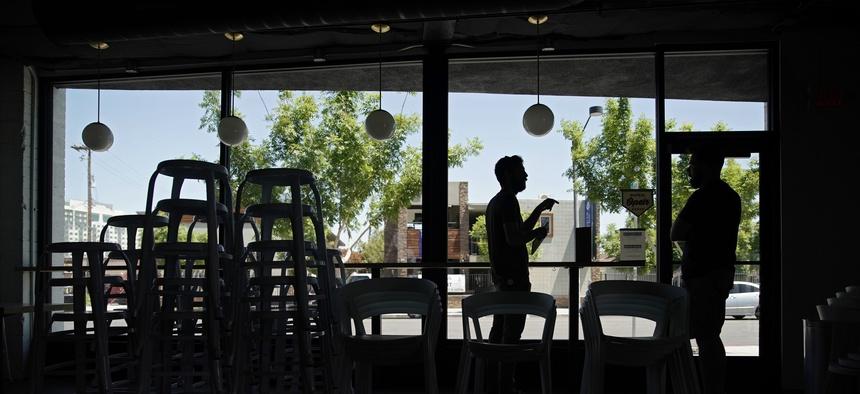 People make preparations for reopening at Vesta Coffee Roasters on May 8, 2020, in Las Vegas.