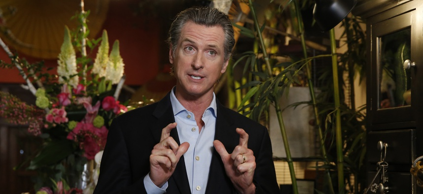 Gov. Gavin Newsom discusses the reopening of businesses during a news conference at Twiggs Floral Design Gallery in Sacramento, Calif. on May 8, 2020.