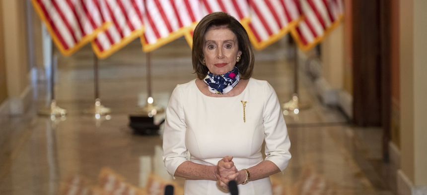 House Speaker Nancy Pelosi of Calif., walks to speak about the so-called Heroes Act, Tuesday, May 12, 2020 on Capitol Hill in Washington. Pelosi unveiled a more than $3 trillion coronavirus aid package.