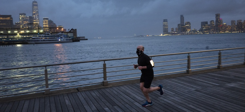 A jogger wears a face mask in New York's Hudson River Park last month. Many Americans who used to manage their anxiety with exercise are now finding that doesn't cut it under the stress and the isolation of the coronavirus epidemic.