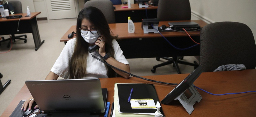 A contact tracer running down contacts of coronavirus patients at the Florida Department of Health in Miami-Dade County.