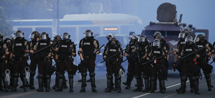 Police in riot gear prepare to advance on protesters, Saturday, May 30, 2020, in Minneapolis. Protests continued following the death of George Floyd, who died after being restrained by Minneapolis police officers on Memorial Day.