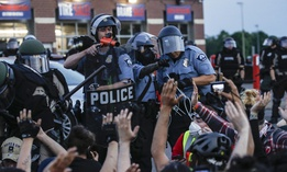 Members of the Minneapolis police arrest protesters on May 31, 2020.