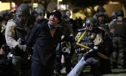 Demonstrators are arrested for a curfew violation Wednesday, June 3, 2020 in downtown Los Angeles during a protest over the death of George Floyd who died May 25 after he was restrained by Minneapolis police.