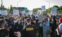 Sheriff Chris Swanson of Genesee County, Michigan, walks with protesters in Flint Township on May 30.