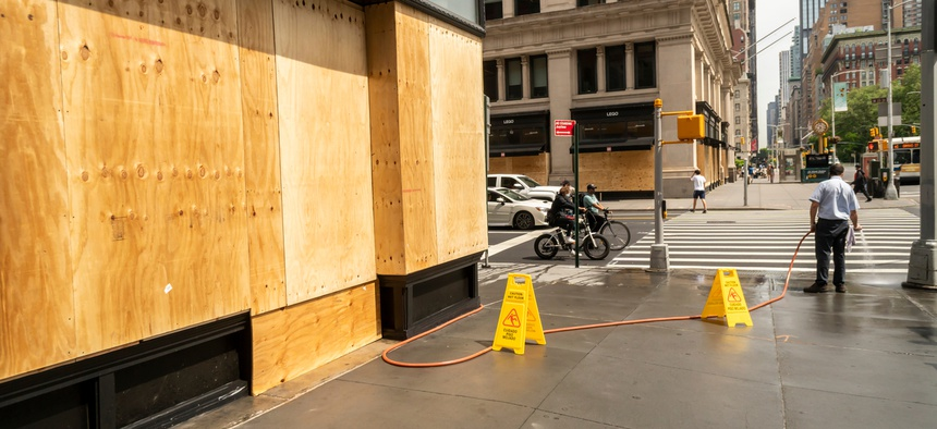 A store in New York City is boarded up.