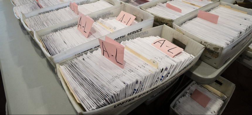 Processed mail-in ballots are seen at the Chester County Voter Services office in West Chester, Pa., prior to the primary election on May 28, 2020.
