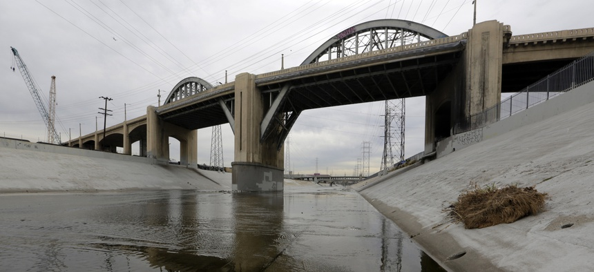 The 6th Street Bridge spans over the Los Angeles River Wednesday, Jan. 27, 2016, in Los Angeles, before it is closed permanently for demolition. The landmark bridge, dating to the 1930s, is being replaced due to deterioration.