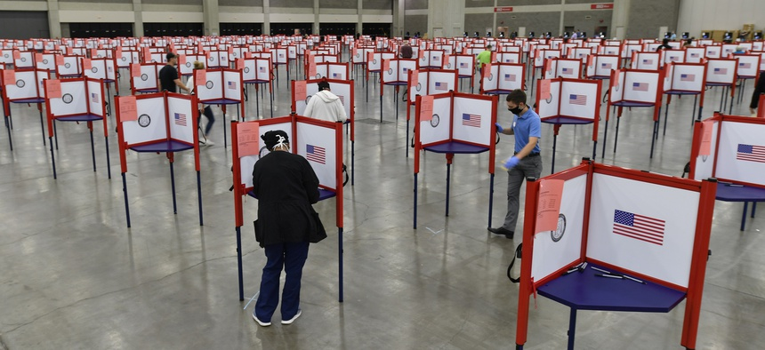 Voting stations are set up in the South Wing of the Kentucky Exposition Center for voters to cast their ballot in the Kentucky primary in Louisville, Ky., Tuesday, June 23, 2020.