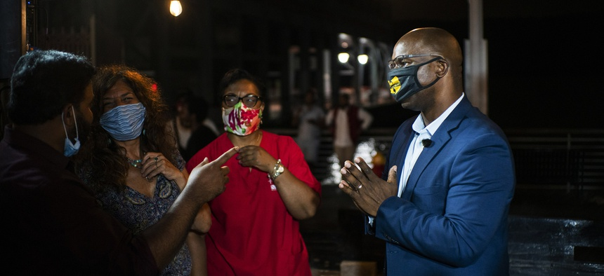 Jamaal Bowman (right) speaks to supporters at a primary night party.