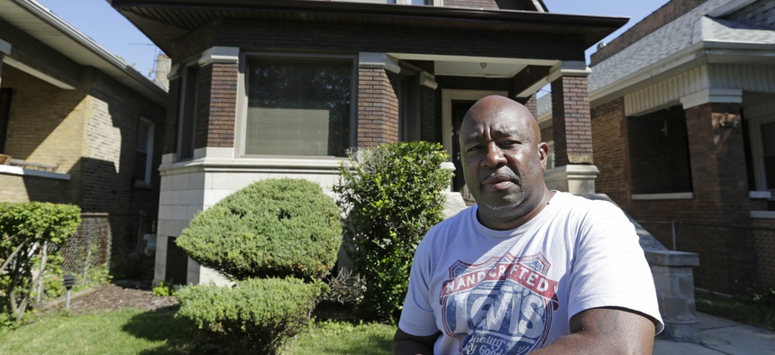 Chicago resident James Young stands outside his home in the Auburn Gresham neighborhood in this file photo. A Chicago Tribune report in 2017 found the city's property tax system placed an unfair burden on poorer residents of minority communities.