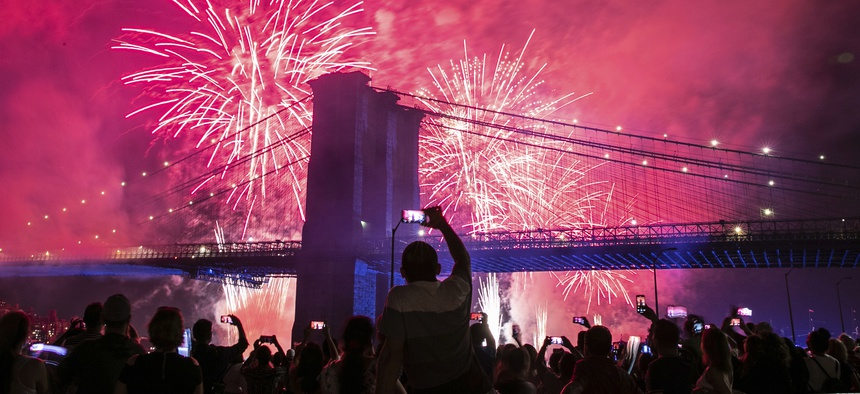 People on the east side of Manhattan watch a fireworks display, part of Independence Day festivities, Thursday, July 4, 2019, in New York.