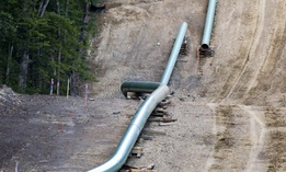 Segments of assembled pipe are lined up along a cleared section of woods where a pipeline for shale gas was under construction during 2017 in Jackson Township, Pa. A new pipeline project in the region has led to controversy.